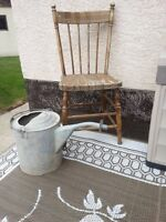 Old wooden chair and gas can