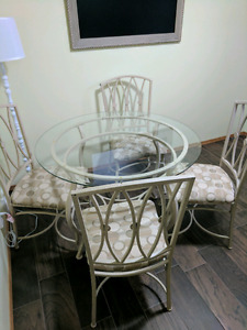 Glass table and four chairs.