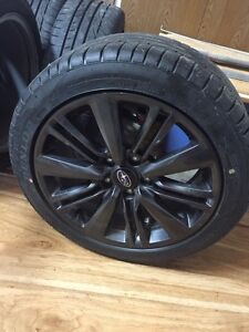Selling subaru rims and tires 100% brand new