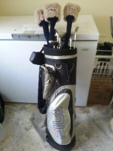 FOR SALE set of FILA women right hand golf clubs and bag.