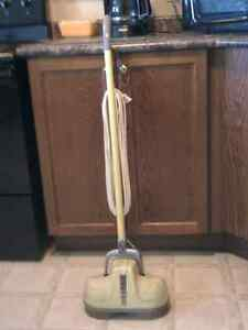 Vintage Floor Polisher, Eureka brand, has some pads