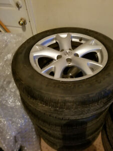 225 60 17 Continental tires 100% tread on Nissan Rogue alloys