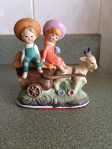 Boy & Girl on Wagon Ceramic Statue