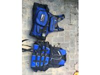 Two buoyancy aids for watersports (kayaking, wake boarding)