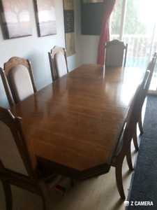 Large solid oak dining room table 6 high back chair's and buffet