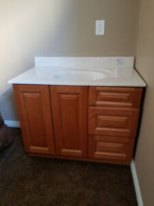 """natural oak cabinet with marble counter top sink , 40"""""""