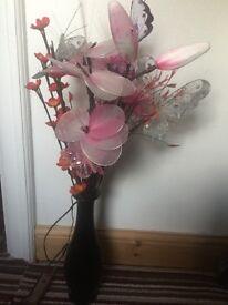 Flower with black vase