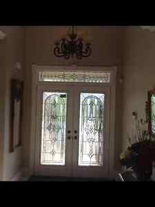 Decorative glass inserts for a double entry door with matching t