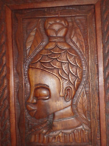 Carved African Woman in carved frame