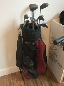 Woman's left handed set of golf clubs with balls and bag