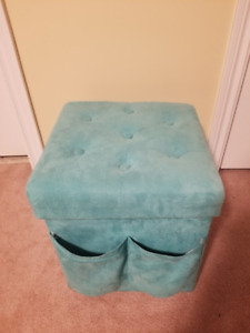Turquoise storage ottoman with matching accessory set.