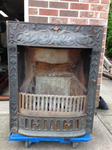antique bronze fireplace insert with working cover