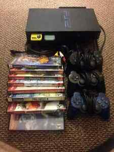 Playstation 2 (PS2) with controllers & 8 (good) games