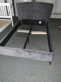 A slight used grey fabric 4ft three quarter bed frame.