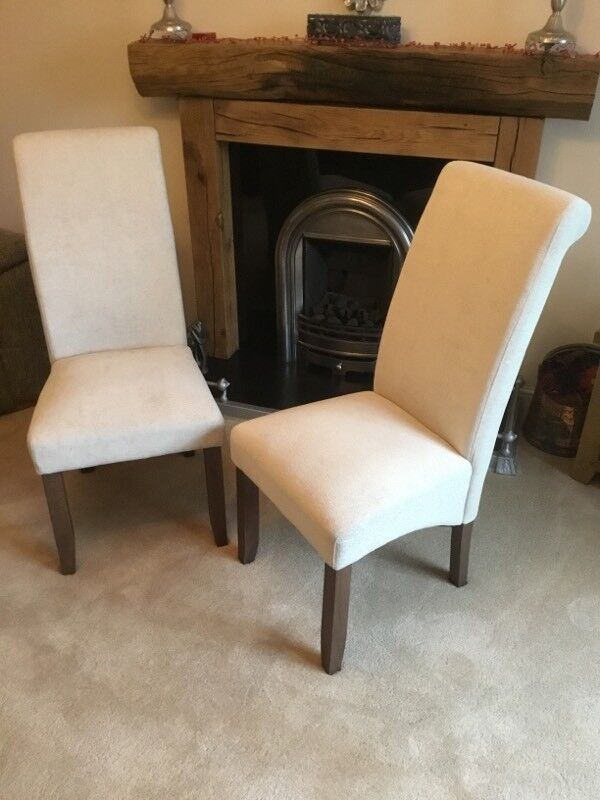 Two Cream fabric dining chairs as new condition