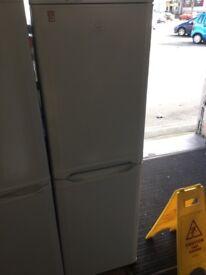 Indesit white fridge freezer 60cm wide 174cm high.