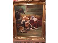 Original oil painting of hound dogs in beautiful gilt frame.