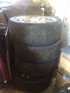 305-35R24 Hancock tires and chrome rims