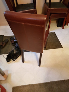 Selling 4 leather chairs in good condition..for B.O.
