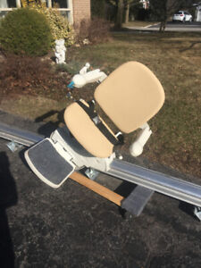 Two stair chair lifts.   Minivator brand.