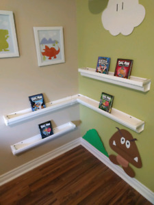 Homemade gutter-style shelves, great for books or stuffies