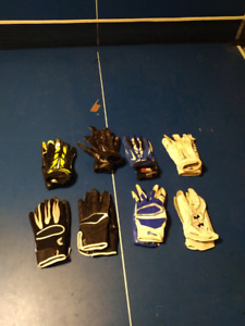 Bunch of pairs of football receiver gloves
