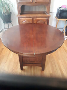 Pedestal table with leaf and four chairs.  Asking $200.  Pick up
