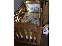 Drop side cot, fisher price bumper quilt and mobile