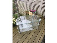 Glass and chrome TV stand. As new