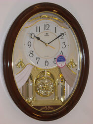 Power Melodies in Motion pendulum wall clock with LED light (PW6132JPMKS2)