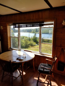 Lakefront Camp for sale on Round Lake