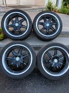 "18"" Mags w/summer tires 235/40/18"
