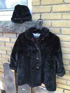 black coat and hat