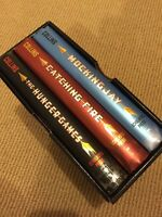 BOXED SET of THE HUNGER GAMES... Brand new condition