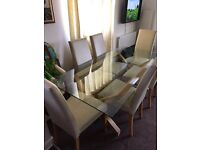 Glass dining table with 6 chairs very good condition