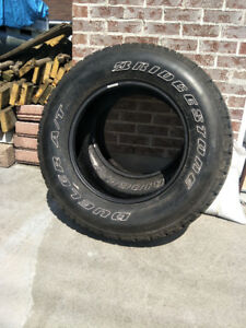 2 new tires, never use        255/70 R18 All season