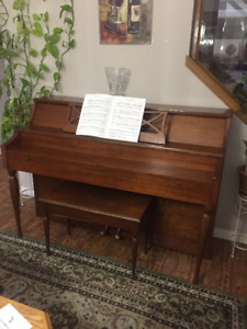 Selling a well maintained Stand Piano with seat and book holder