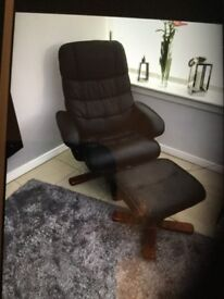 Black leather look swivel chair and footstool