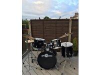 8 Piece drum kit with sticks