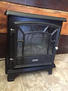 Electric wood stove with heat