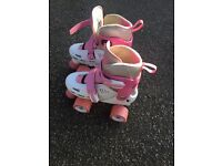 Girls adjustable quad roller skates sizes 12-2 UK £15.00.