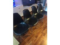 Four Vitra Eame style dinning chairs