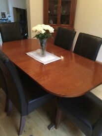Solid dining room table and 6 chairs