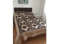 Double divan bed with suede brown headboard