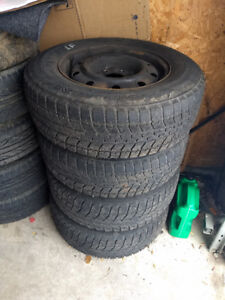 Set of four 5 x114.3 Chrysler steel wheels with 15 inch Blizzaks