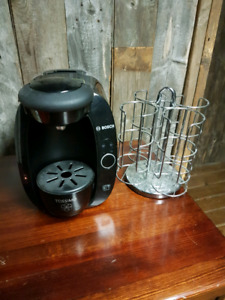 Tassimo coffee machine with stainless steel coffee storage holde
