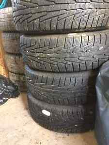 4 Nokian winter tires on aluminum land rover rims