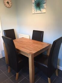 Oak table and 4 brown faux leather chairs