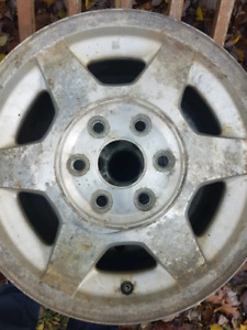 "Four GMC 16"" rims"