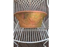 Nicely weathered large terracotta wall planter